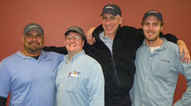 Scott, second from left, is shown with his fellow team members