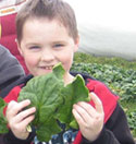 Student enjoying healthy snack thanks to REAP Food Group