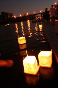 Peace lanterns float along the Milwaukee River