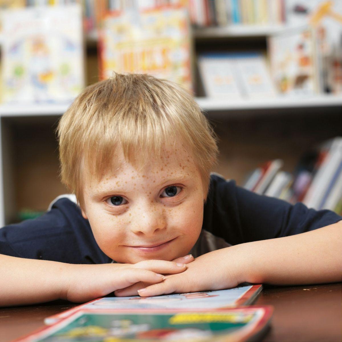 little boy reading book DRW