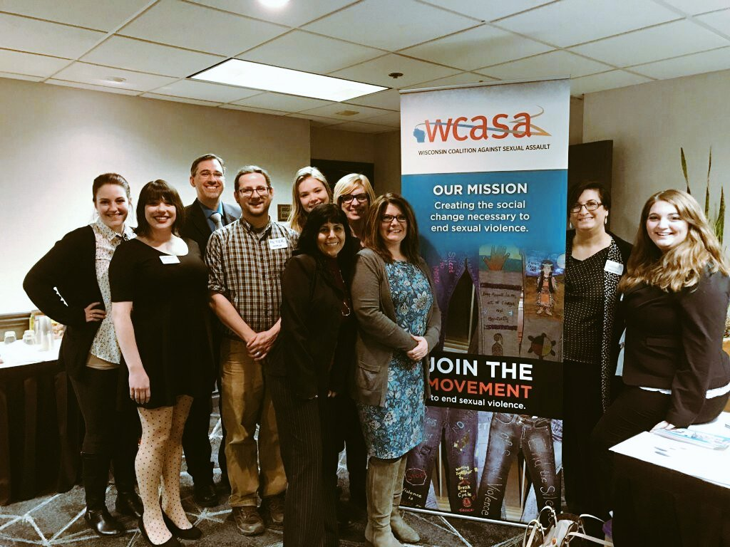 wcasa workers and banner highlighting organization goals