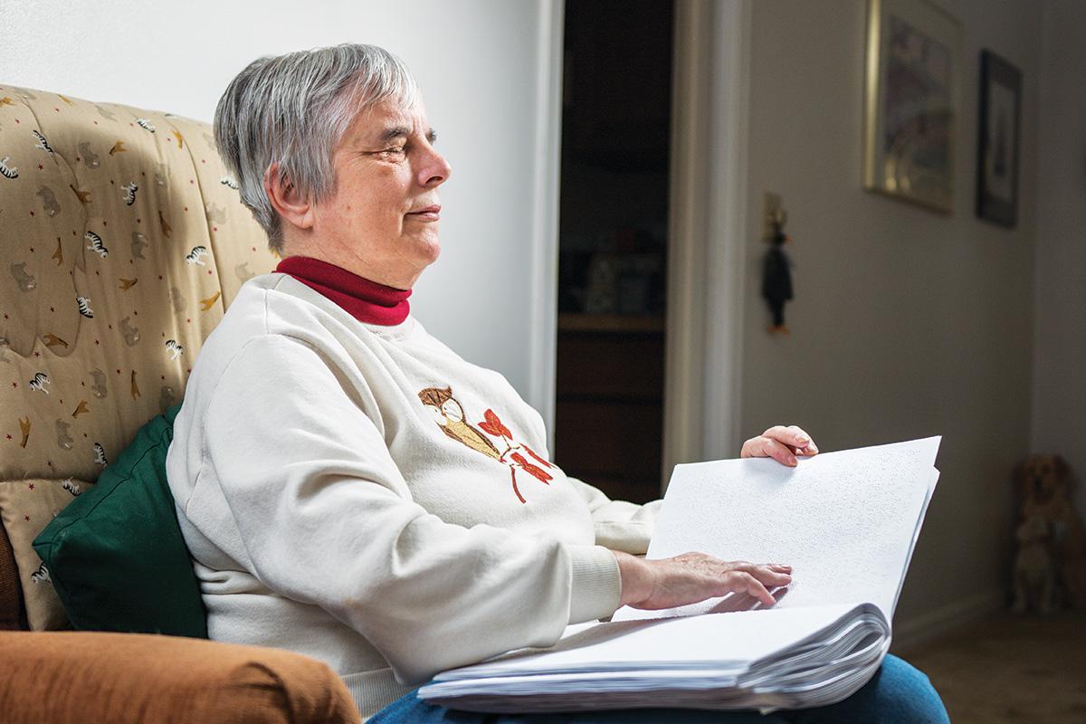 Woman Reading Brail