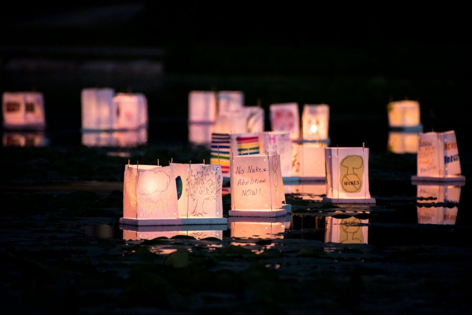 physicians for social responsibility photo of lanterns with messages written on them